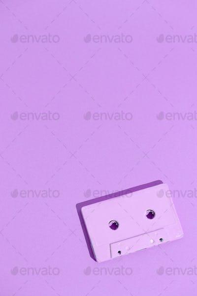 Minimal aesthetic still life monochrome design. Purple trends. Audio cassette