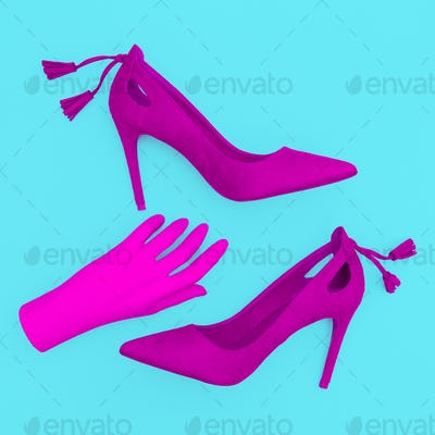 Pink velvet shoes and hand. Fashion minimal concept