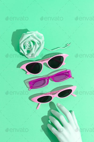 Fashion accessories still life concept. Stylish sunglasses set. 90's aesthetic mood.
