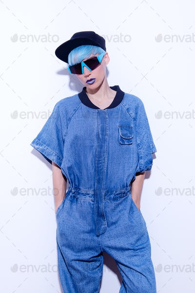 Tomboy Girl with short blue colored hair. Trendy haircut concept