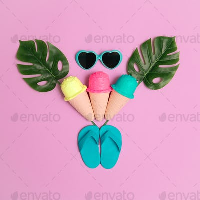 Vacation beach fashion mood. Ice cream, flip-flop, sunglasses. Minimal flat lay art