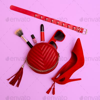 Red clutch, cosmetics and Lady accessories. Focus on red
