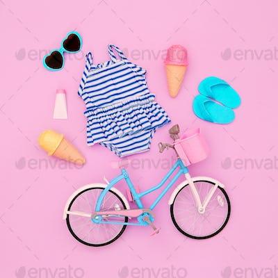 Vacation beach set. Ice cream, flip-flop, sunglasses, swimsuit, bicycle. Minimal flat lay