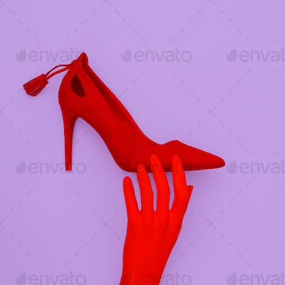 Red shoes and fake hand. Minimal fashion vibes