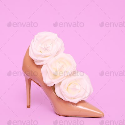 High heel shoes and white roses. Lady fashion concept