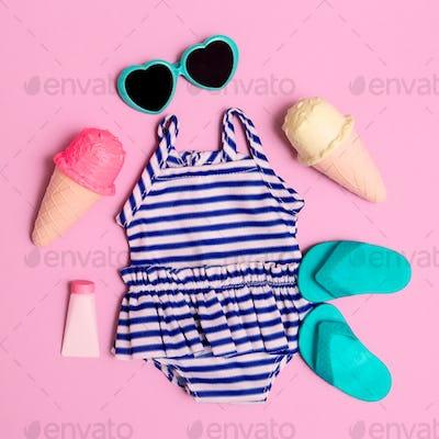 Vacation beach set. Ice cream, flip-flop, sunglasses, swimsuit. Minimal flat lay