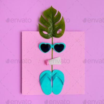 Vacation beach mood. Flip-flop, sunglasses. Minimal flat lay art