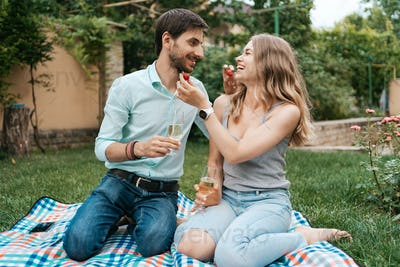 Couple drinking sparkling wine with strawberries