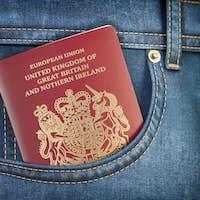 UK United Kingdom passport in pocket jeans