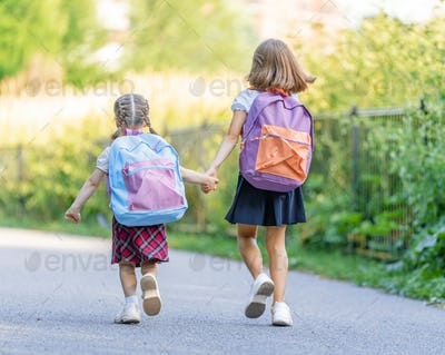 Girls with backpack are going to school