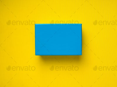 Blue gift box on yellow background