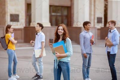 Cheerful Student Girl Having Coffee During Break Standing Outside University