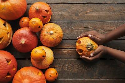 Woman Holding Pumpkin Flat Lay