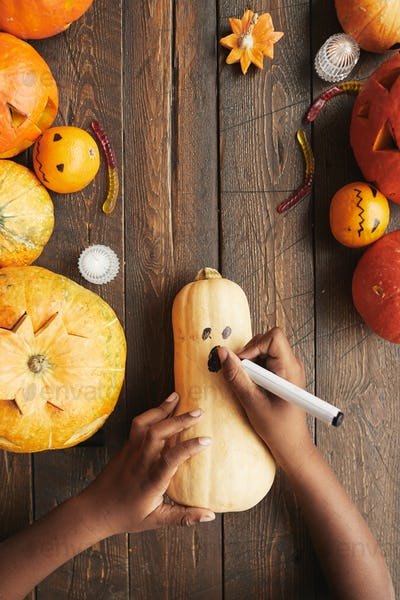 Drawing Face On Gourd