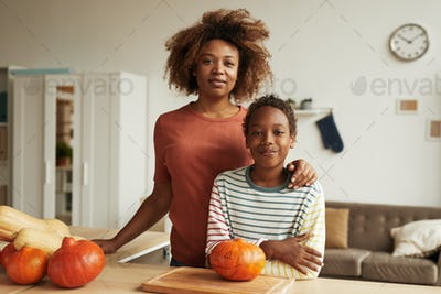 Mother And Her Son Ready To Carve Pumpkins