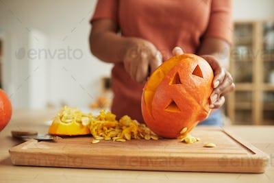 Unrecognizable Woman Carving Pumpkin