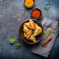 Indian baked stuffed pastry samosa