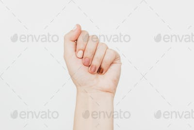 Female fist protesting on white background