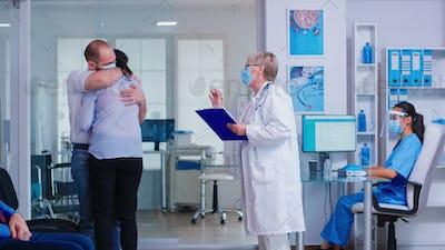Senior doctor giving bad news