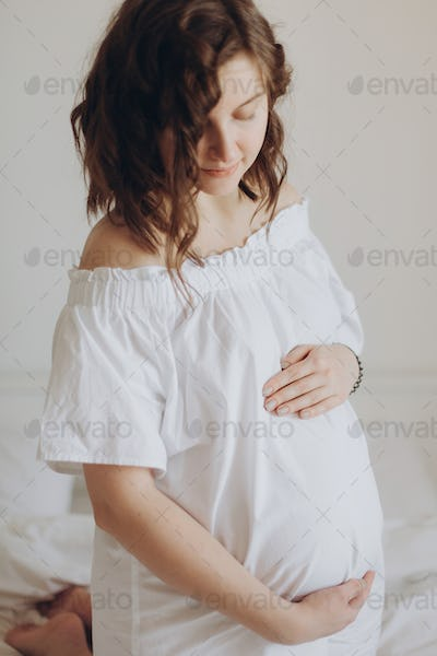 tylish pregnant mom waiting for baby