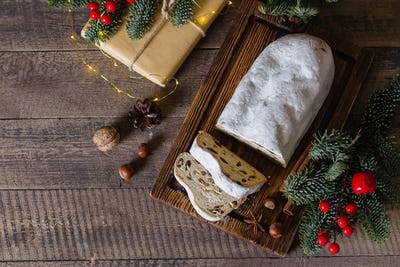 Traditional Christmas festive pastry dessert with festive decoration. Christmas stollen