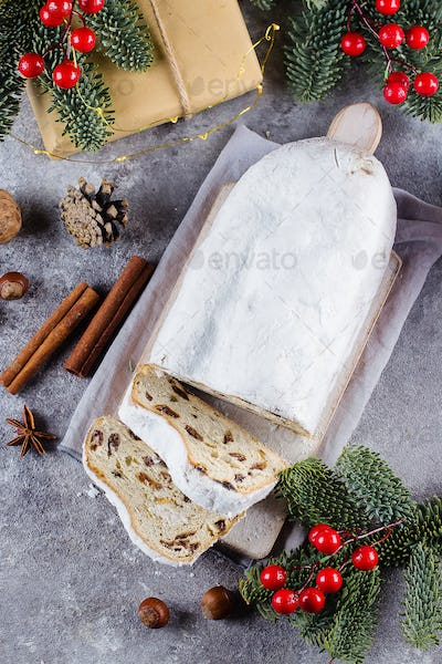 Traditional Christmas festive pastry dessert with festive decoration. Christmas stollen. Top view