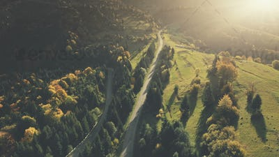 Colorful hill forest country road aerial view