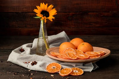 Beautiful composition of oranges and sunflower