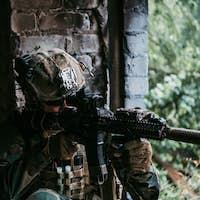 Soldier in combat. Urban combat training, soldier entering abandoned building. Anti terrorist