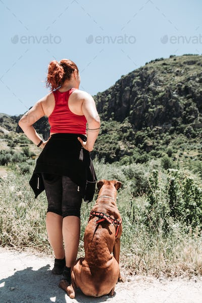 girl explore sierra nevada at summer with a dog