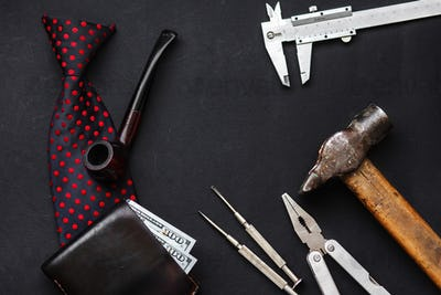 Working tools, bow tie leather wallet with money wooden tobacco pipe and razor