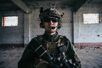 Soldier preparing tactical gear for action battle