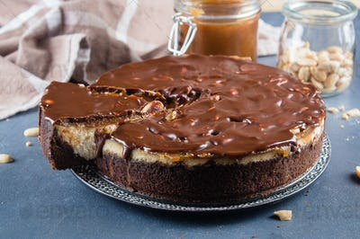 Cheesecake Snickers with chocolate, caramel, peanut paste, Nougat and Peanut Layered Cake
