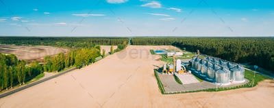 Aerial View Granary, Grain-drying Complex, Commercial Grain Or Seed Silos In Sunny Spring Rural