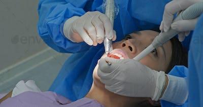 Woman undergo dental scaling treatment