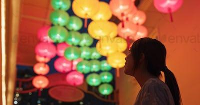 Woman look at the chinese lantern at night