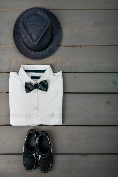 Mens outfit on wooden background, Kids fashion clothes.
