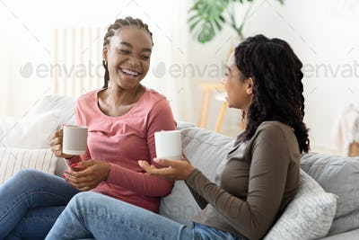 Young african women having fun at home