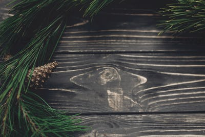 Green tree fir branches and pine cones anise top view on rustic wooden background