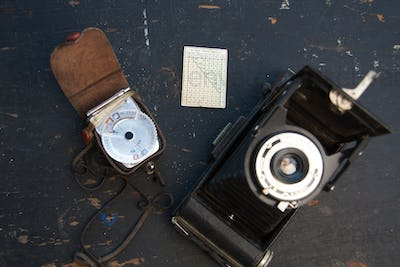 retro camera on the black background with slides
