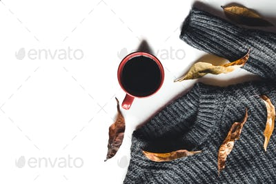 Autumn composition. Cup of coffee, sweater on white background. Autumn, fall concept