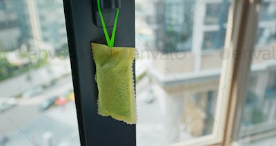Hanging a pack of the refresher for Mosquito Repellent