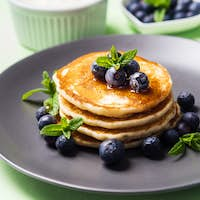 Stack of home made pancakes with fresh berries