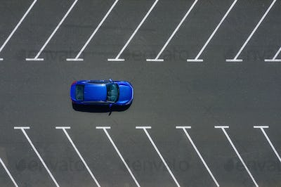 Transportation. View on the car from the air. Car in an empty parking lot.