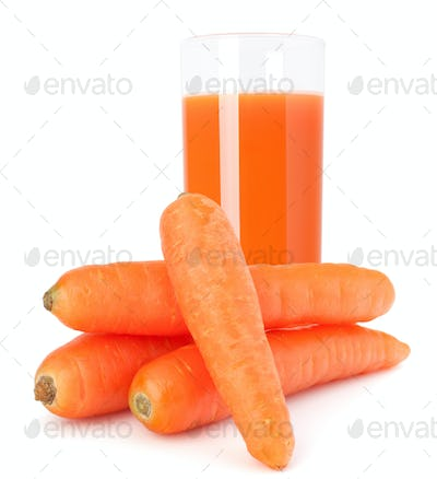Carrot juice glass and carrot tubers