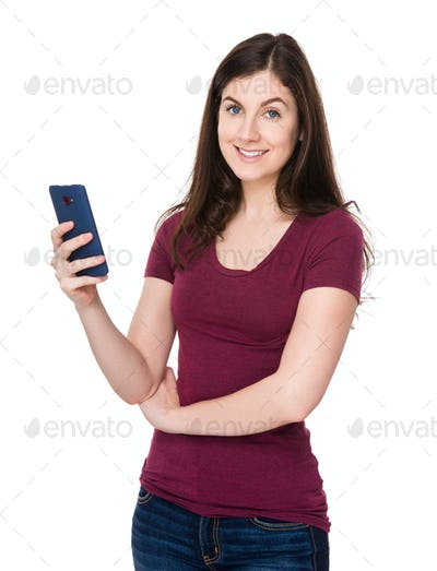 Brunette woman use of the mobile phone