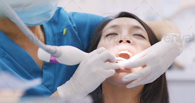 Woman doing Scaling and root planing in dental clinic
