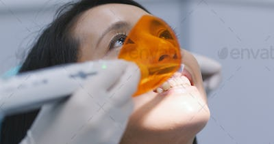 Dental restoration and material polymerization with UV light