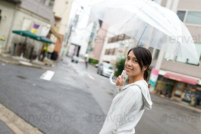 Woman holding an umbrella in japan city