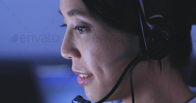 Customer services operator working at night